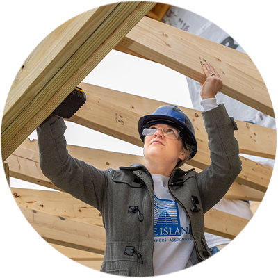 RIMBA Volunteer Kerri Tracy helps build a house for Habitat for Humanity
