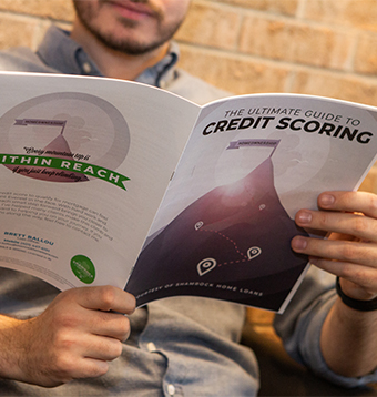 A man is reading the credit scoring ebook.